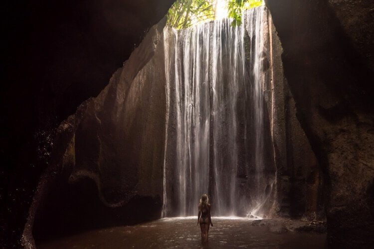 Tukad Cepung is a real hidden gem in Bali and a must-visit to see the special light beam formed by the sun's rays coming through the rock opening.