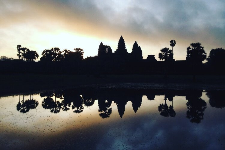 one of the most famous landmarks in asia is Angkor Wat. here it is at sunrise.